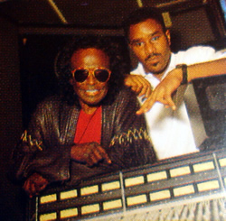 Easy Mo Bee/Miles Davis – This image of Miles and Easy Mo Bee in the studio was taken by Michael Benabib and used on the album's liner notes