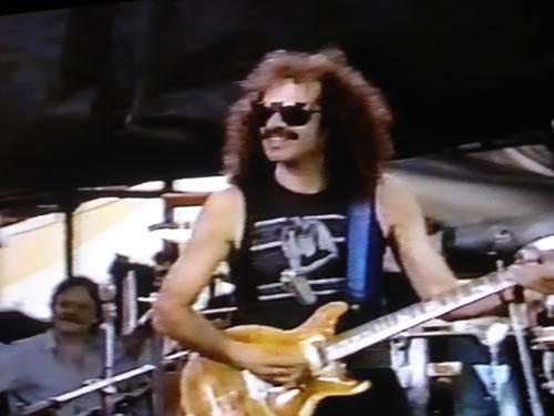 Carlos Santana playing with Miles Davis, Giants Stadium, New Jersey 1986